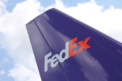 Oshkosh, WI, USA - July 30, 2014 FedEx Express Airbus A300-600F airplane on the ramp at the Oshkosh Airport from Madison.